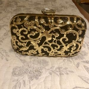 A fawziya handbag gold and black.